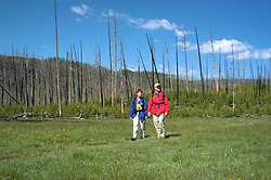 WY: Wyoming; Yellowstone National Park.In Midway Geyser Basin.Couple hiking near Fairy Falls, Model Released.Photo #: yellow1498.Photo copyright Lee Foster, 510/549-2202, lee@fostertravel.com, www.fostertravel.com..