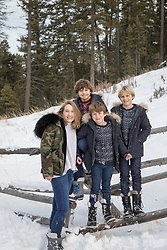 brothers and sister outdoors at Wintertime