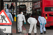 36 hours after the London Bridge and Borough Market terrorist attack, the capital returns to normality and Londoners return to their first day to work while Scenes of Crime Officers SOCO scour looking for more evidence, on Monday 5th June 2017, in the south London borough of Southwark, England. Seven people were killed and many others left with life-changing injuries - but the British spirit of defiance and to carry on with every day life, endures.