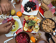 Breakfast of olives, oranges, pomegranate, nuts, dried tomatoes etc. At the home and field of Manolis Vardakis, in Pyrgos village. village.