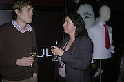 Simon Burgess and Alida Campbell, Drinks party to launch a new Thomas Pink shirt called The Mogul which has a pocket which houses one's cigar. Hostyed by the Spectator and Thomas Pink. Floridita. Wardour St. London. 1 November 2006. -DO NOT ARCHIVE-© Copyright Photograph by Dafydd Jones 66 Stockwell Park Rd. London SW9 0DA Tel 020 7733 0108 www.dafjones.com