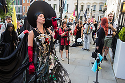 London, UK. 2 July, 2019. Climate change activists from Extinction Rebellion Art and Culture protest outside the offices of British Petroleum (BP) during a silent procession visiting the offices of five major oil companies - ENI, CNPC, Saudi Aramco, Repsol and BP - to declare them a crime scene.