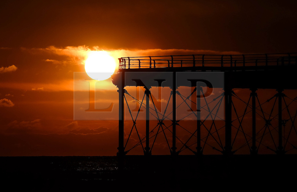 © Licensed to London News Pictures. <br /> 29/04/2016. <br /> Saltburn by the Sea, UK.  <br /> <br /> The rising sun is seen against the end of the pier at Saltburn by the Sea. Further bad weather is expected to come down from the Arctic bringing snow and freezing temperatures to many northern and eastern parts of the country.<br />  <br /> Photo credit: Ian Forsyth/LNP