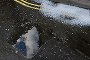 Ice cubes melt alongside ripples in a roadside puddle in Soho in the West End, on 2nd July 2020, in London, England.