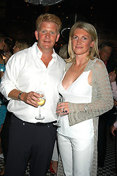 SARAH, MARCHIONESS OF MILFORD-HAVEN and MR PETER BURRELL at a party hosted by Frankie Dettori, Marco Pierre White and Edward Taylor to celebrate the launch of Frankie's Italian Bar & Grill at 3 Yeoman's Row, London SW3 on 2nd September 2004.