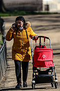 A couple walks through St James's Park in London, Monday, March 23, 2020. The British government is encouraging people to practice social distancing to help prohibit the spread of Coronavirus, further restrictions may be imposed if the public do not adhere to their advice. (Photo/Vudi Xhymshiti)