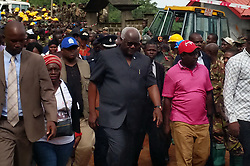 (170815) -- FREETOWN, Aug. 15, 2017 (Xinhua) -- Sierra Leone's President Ernest Bai Koroma (Front C) inspects the site of mudslide in Freetown, Sierra Leone, on Aug. 15, 2017. Government of Sierra Leone is expected on Tuesday to undertake the burial of the majority of corpses of victims in the devastating mudslide which had claimed nearly 300 lives, sources close to the government told Xinhua.  (Xinhua/Wang Bo) (zf) (Photo by Xinhua/Sipa USA)