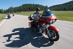 Throttle Girl Kelly Quin on the Harley-Davidson Women's Angels Ride to benefit the Nature Conservancy during the annual Sturgis Black Hills Motorcycle Rally. SD, USA.  August 12, 2016.  Photography ©2016 Michael Lichter.