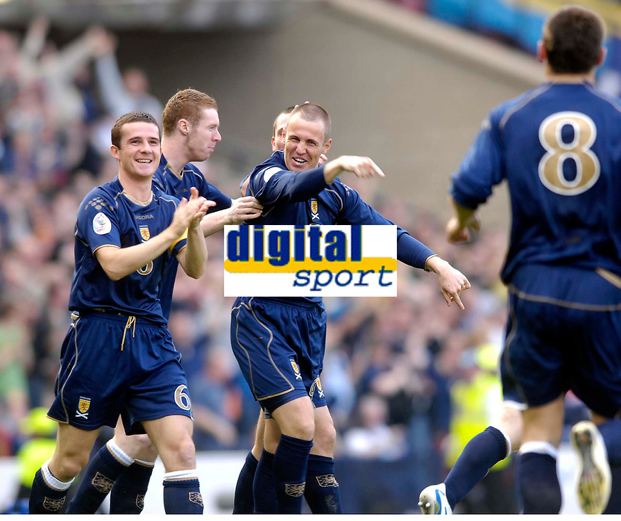 Photo: Jed Wee/Sportsbeat Images.<br /> Scotland v Ukraine. UEFA European Championships Qualifying. 13/10/2007.<br /> <br /> Scotland goalscorer Kenny Miller (C) and Barry Ferguson (L) applaud the input of Lee McCulloch in the opening goal.