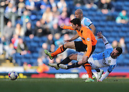 Jay Spearing, Blackburn Rovers midfielder fouls Joao Carlos Teixeira, Brighton midfielder during the Sky Bet Championship match between Blackburn Rovers and Brighton and Hove Albion at Ewood Park, Blackburn, England on 21 March 2015.