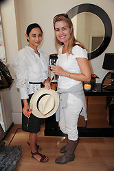 Left to right, HANNAH BHUIYA and ANDREA HAMILTON at a party hosted by Maria Hatzistefanis to celebrate the publication of Santa Montefiore's new book 'The Affair' held at 35 Walpole Road, London on 27th April 2010.