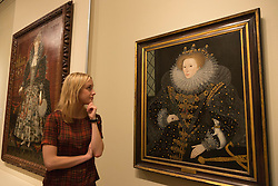 "© Licensed to London News Pictures. 09/10/2013. London, England. A museum worker stands in front of the paiting ""Queen Elizabeth I, The 'Ermine' Portrait"" attributed to Nicholas Hilliard, 1585. Press preview of the exhibition ""Elizabeth I & Her People"" at the National Portrait Gallery which explores the remarkable reign of Elizabeth I through the lives and portraiture of her subjects. Exhibition runs from 10 October 2013 to 5 January 2014. Photo credit: Bettina Strenske/LNP"