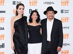"""Director and Actress Angelina Jolie, left, Loung Ung, centre, and Rithy Panh pose for photographs on the red carpet for the movie """"First They Killed My Father"""" during the 2017 Toronto International Film Festival in Toronto, ON, Canada, on Monday, September 11, 2017. Photo by Nathan Denette/CP/ABACAPRESS.COM"""