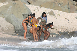 EXCLUSIVE: World's fastest man Usain Bolt chats to bikini babes while girlfriend Kasi Bennett has sand hand prints applied to her booty. The Jamaican sprinter and nine-time Olympic gold medalist chilled out while Kasi showed off her stunning physique in a skimpy yellow bikini while holidaying with friends in St Bart's. Casi, a brunette beauty from the Jamaican town of Old Harbour, is Bolt's long time girlfriend. 08 Jul 2018 Pictured: Kasi Bennett in yellow bikini. Photo credit: MEGA TheMegaAgency.com +1 888 505 6342