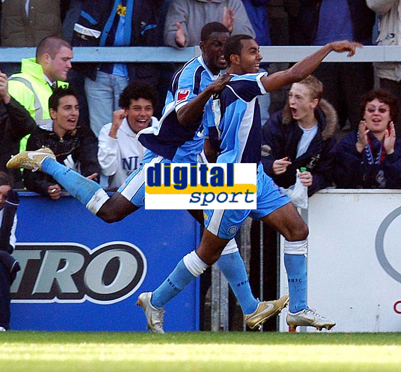 Photo: Alan Crowhurst.<br />Wycombe Wanderers v Peterborough United. Coca Cola League 2. 21/10/2006. Wycombe's Kevin Betsy (R) celebrates his goal 1-0.