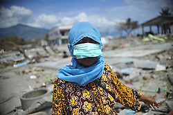 Oct. 8, 2018 - Post, Sulawesi, Indonesia - A villager stands on the ruins of her house in earthquake affected Poso, Central Sulawesi province. The death toll from multiple strong quakes and an ensuing tsunami in Indonesia's Central Sulawesi province jumped to 1,944. (Credit Image: © Zulkarnain/Xinhua via ZUMA Wire)