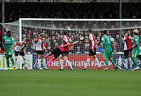 Football - 2018 / 2019 FA Cup - Third Round: Woking vs. Watford<br /> <br /> Will Hughes's shot flies past goalkeeper,Craig Ross for Watford's first goal, at Kingfield Stadium.<br /> <br /> COLORSPORT/ANDREW COWIE