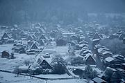 Scenic view of village at dusk during winter, Shirakawa-go, Japan