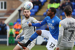 Reece Brown of Peterborough United in action with Ben Close of Portsmouth - Mandatory by-line: Joe Dent/JMP - 07/03/2020 - FOOTBALL - Weston Homes Stadium - Peterborough, England - Peterborough United v Portsmouth - Sky Bet League One