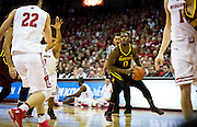 Guard Akeem Springs (0) eyes a three point basket during the first half of the University of Minnesota Men's Basketball game versus University of Wisconsin on March 5, 2017.