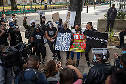 © Licensed to London News Pictures. 09/06/2020. London, UK. People mark the funeral of George Floyd with a minute's silence in Parliament Square. Protests have taken place across the United States and in cities around the world in response to the killing of George Floyd by police officers in Minneapolis on 25 May. Photo credit: Rob Pinney/LNP