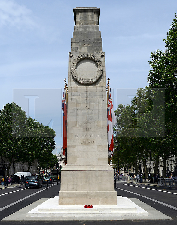 © Licensed to London News Pictures. 14/06/2012. London, UK. On the 30th anniversary of the Argentinian surrender that marked the end of the Falklands War a lone wreath of poppies sits on the base of the Cenotaph in Westminster today 14th June 2012. .. Photo credit : Stephen Simpson/LNP