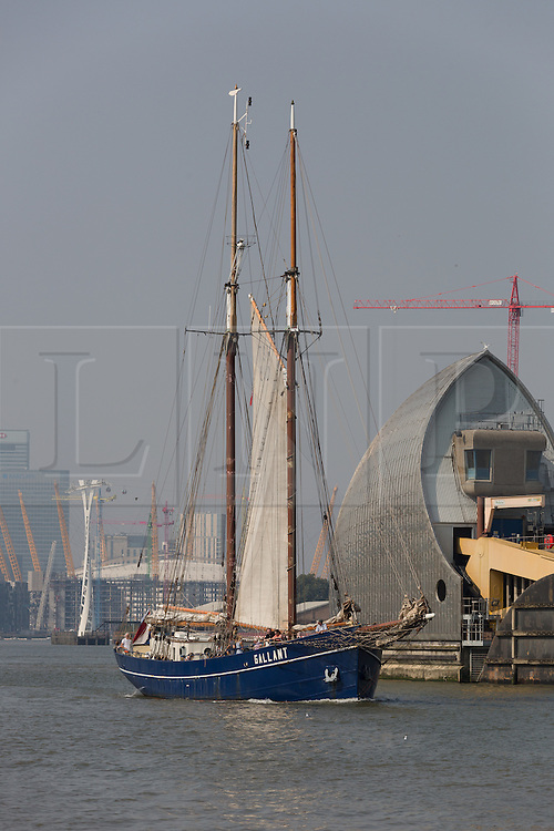 © Licensed to London News Pictures. 15/06/2016. LONDON, UK.  The historic tall ship, Gallant passes through the Thames Barrier, in front of Canary Wharf and the O2 on the River Thames. The Sail Royal Greenwich Tall Ship Festival runs until this Sunday, 18th Septmeber.  Photo credit: Vickie Flores/LNP
