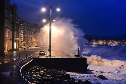 © London News Pictures. 03/01/2018. Aberystwyth, UK.  Storm Eleanor, the fifth named storm of the winter, hits Aberystwyth Wales, with westerly winds gusting up to 80mph bringing huge waves crashing against the sea defences at high tide on Wednesday morning at 8am. Photo credit: Keith Morris/LNP