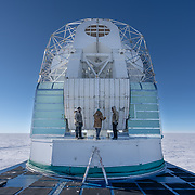 The 10 meter South Pole Telescope during scheduled maintenance. Greasing the gears.