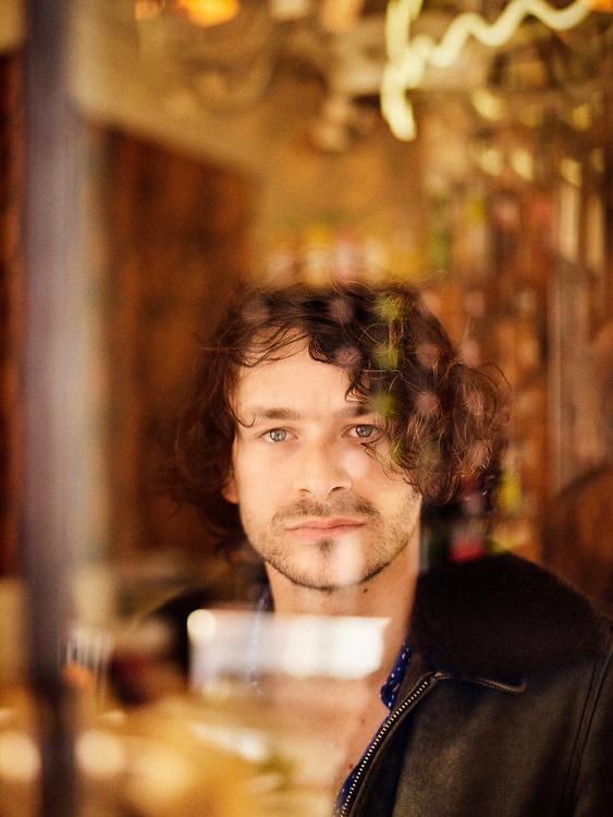 "Sebastien Wolf, member of the band ""Feu ! Chatterton"" (keyboard / guitar), posing at the ""Chez Jeanette"" cafe. Paris, France. March 22, 2019.<br /> Sebastien Wolf, membre du groupe ""Feu ! Chatterton"" (clavier / guitare), posant dans le cafe ""Chez Jeanette"". Paris, France. 22 mars 2019."