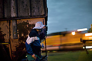 "Hopping freight train near Milwauke with 43 year old Hobo names Stretch. ..Life of a Hobo nicknamed Stretch. Stretch was elected Hobo King in 2009, at the National Hobo convention. A Hobo is a term which is applied to a migratory worker or homeless vagabond, often penniless. Hobos move around the country, looking for work by hopping illegally on freight trains, which can be a dangerous enterprise. Modern freight trains are much faster and harder to ride than in the 1930s, but can still be boarded in railyards..The first and most important rule of the hobo code is 'decide your own life', which meant 'do what you want to do'...A 4-weeks road trip across the USA, from New York to San Francisco, on the steps of Jack Kerouac's famous book ""On the Road"".  Focusing on nomadic America: people that live on the move across the US, out of ideology or for work reasons."