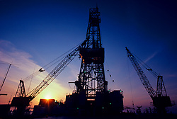 Stock photo of a semi-submersible offshore drilling rig at sunset