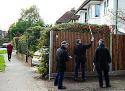 © Licensed to London News Pictures. 11/10/2015. London, UK. Police perform fingertip searches at houses near he scene outside the RE bar in Field End Road, Eastcote, Hillingdon where a man was stabbed to death early this morning (SUN). The victim is believed to be  21-year-old Josh Hanson from Kingsbury.  Photo credit: Ben Cawthra/LNP