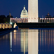 Washington Monument at night with reflection on the Reflecting Pool