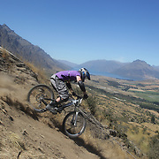 Connor Harvey from Invercargill in action during the New Zealand South Island Downhill Cup Mountain Bike series held on The Remarkables face with a stunning backdrop of the Wakatipu Basin. 150 riders took part in the two day event. Queenstown, Otago, New Zealand. 9th January 2012. Photo Tim Clayton
