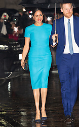 Prince Harry, Duke of Sussex and Meghan, Duchess of Sussex, wearing a Victoria Beckham turquoise blue midi pencil dress,  attend the annual Endeavour Awards at Mansion House in London on March 05, 2020.