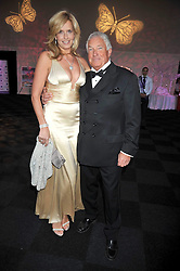PENNY LANCASTER and her father GRAHAM LANCASTER at The Butterfly Ball in aid of the Caudwell Children Charity held in Battersea park, London on 14th May 2009.