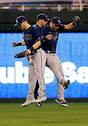 Tampa Bay Rays' Corey Dickerson, left, Cesar Puello, center, and Peter Bourjos, right, celebrate at the end of a baseball game against Kansas City Royals at Kauffman Stadium in Kansas City, Mo., Wednesday, Aug. 30, 2017. The Rays beat the Royals 5-3. (AP Photo/Colin E. Braley)