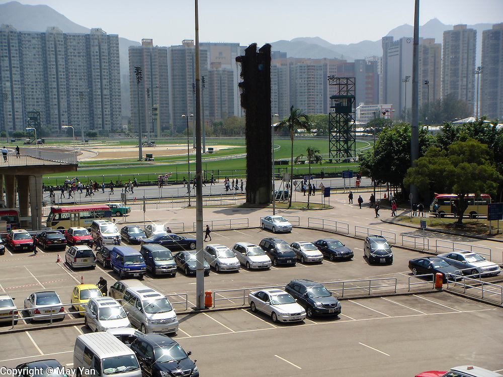 Mid day sun reflecting off the cars parked at the Sha Tin Racecourse in Hong Kong.