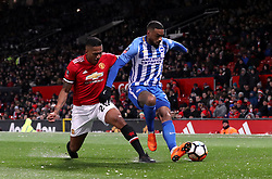 Brighton & Hove Albion's Jurgen Locadia (right) and Manchester United's Antonio Valencia battle for the ball during the Emirates FA Cup, quarter final match at Old Trafford, Manchester.