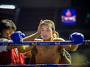 27 JULY 2015 - BANGKOK, THAILAND: A boxer between rounds at Rajadamnern Boxing Stadium (also spelled Ratchadamnoen Stadium). It is Bangkok's oldest venue for Muay Thai. It hosts bouts on Monday, Wednesday, Thursday and Sunday. Ringside seats are about 2,000 Thai Baht (approximately $57 US). The stadium hosted its first fight in December, 1945.        PHOTO BY JACK KURTZ