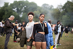 © Licensed to London News Pictures . 12/08/2018. Manchester , UK . KISHA SHEARER (16) and AALYAH READ (17) from Crumpsall . The second day of the annual Caribbean Carnival in Alexandra Park in Moss Side , celebrating music , food and Afro-Caribbean culture . A nearby shooting overnight lead to at least ten people injured . Ten people are in hospital . Photo credit : Joel Goodman/LNP