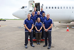 CARDIFF, WALES - Saturday, June 4, 2016: Members of the Welsh Police Football Delegation team pose for a photograph on the steps of the aircraft at Cardiff Airport as the Wales football squad head to Sweden for their last friendly before the UEFA Euro 2016 in France. (Pic by Paul Greenwood/Propaganda)