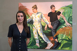 """© Licensed to London News Pictures. 04/09/2020. LONDON, UK. Ania Hobson (with """"Ferns"""") at the preview of her new exhibition at Hampstead's Catto Gallery. In her debut solo London show, the former winner of the BP Portrait Young Artist Award is exhibiting her newest set of paintings which celebrate modern women, 5 to 23 September.  Photo credit: Stephen Chung/LNP"""