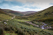The path leading up the Anafon valley in the Carneddau. A pipe line connected to the Ynni Anafon Energy hydro input crosses the river. The valley is located south of the village of Abergwyngregyn just inside the northern boundary of the Snowdonia National Park and 4 km west-south-west of Llanfairfechan, Gwynedd, North Wales.