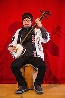 The shamisen is a plucked stringed instrument similar a banjo with its strings stretched across a resonating body. The body do resembles a drum as it has a hollow body covered with a cats skin. Shamisen literally three strings may derive from the Chinese instrument sanxian. Shamisen are played with a plectrum called a bachi. Shamisen is used to accompany kabuki, folk songs and puppet plays