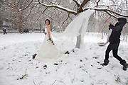 London, UK. Sunday 20th January 2013. Chinese bride to be Sa Sa (27) having some wedding pictures taken as snow fall covers St James's Park in London. She is due to get married in the Summer in the UK to her fiance Tao Wei (26).