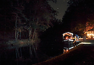 Cuddebackville, N.Y. - A man walks toward the Neversink Kate canal boat after a nightime ride on the D&H canal organized by the Neversink Area Museum on Oct. 14, 2006. ©Tom Bushey / The Image Works