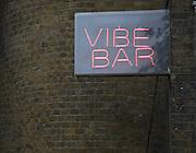 Vibe Bar neon sign, Brick Lane, London, E1, England
