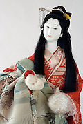 Japanese doll in traditional dress with hands still in a protective soft covering